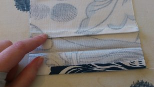 Step 6.5. Sew the fold you made in step 6.3. Press the fold up like in the picture.