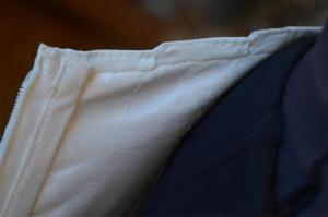 Detailed view of the inside of the neckline. Notice the two seams needed to keep it in check.